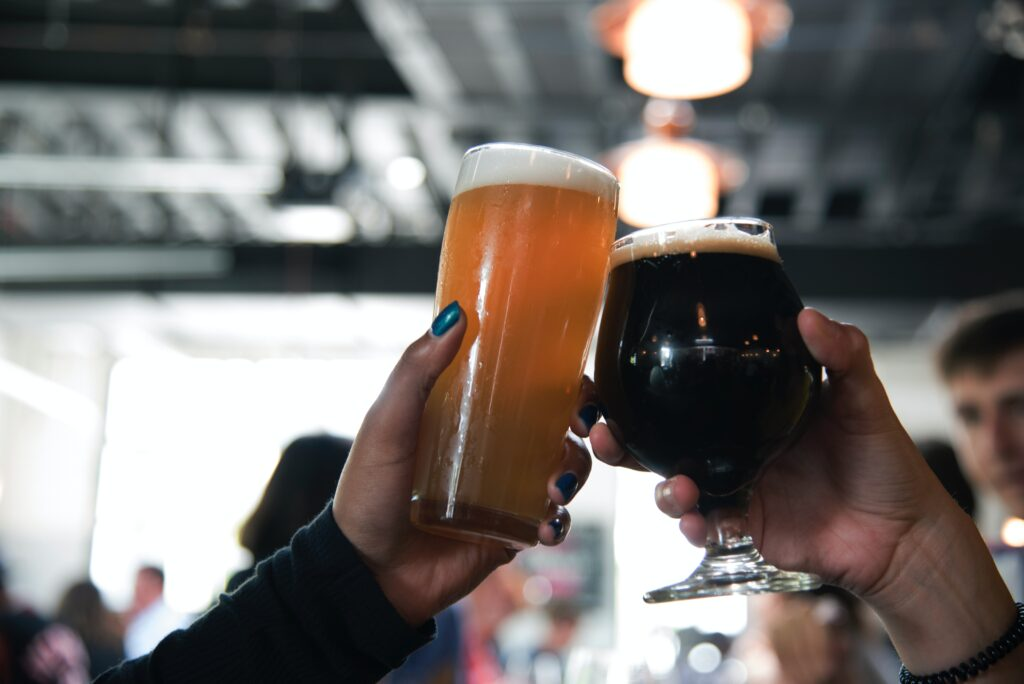 A couple cheers some glasses of craft beer